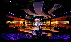 Stage set design with large decorative shapes and lighting