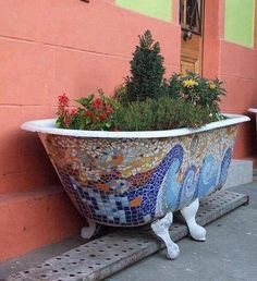 Mosaic bathtub turned flower bed