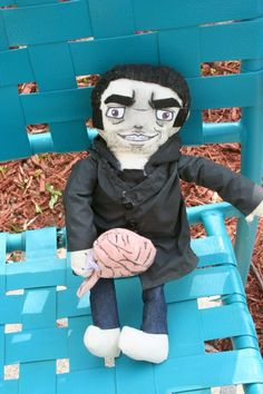 Handmade by a guest artist Crystal. This is a doll of our favorite bad boy Sylar from Heroes.  He is made with hand and machine sewn clothing and felt hair. He has real jeans and a black hoodie type jacket. He is also holding a brain :)  He would make an awesome gift for a fan.   The dolls ar...
