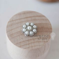 Small pearl cluster embellishment for decorating wedding invitations, stationery and paper crafts.
