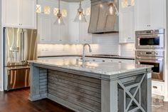 I live the end of this kitchen island with its unique shape and applied moldings by Stonecroft Homes