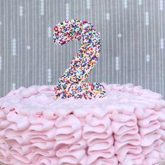http://kojo-designs.com/2012/08/sprinkle-cake-topper/
