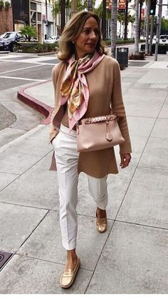 Loafers, white pants, and a silk scarf makes for the perfect sophisticated  outfit for women over 50 b7b7476c36