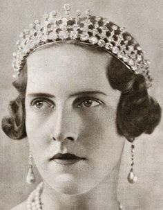 A diamond tiara, worn here by Princess Irene of Greece, has it's roots in Britain. It was originally given by Queen Victoria to her daughter, Vicky; who gave it to her own daughter Sophia, who married into the Greek Royal family. Sophia gave it to her daughter Irene, who married the Duke of Savoy in 1939. Sadly, this tiara was auctioned by Christie's in 1979, and its current whereabouts is unknown.