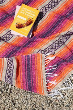 This woven beach blanket is perfect for festival season.