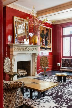 A red-lacquered living room designed by artist Mickalene Thomas features sofas by Ena Swansea. Living Room Red, Cozy Living Rooms, Living Room Decor, Red Room Decor, Sitting Rooms, Manhattan Apartment, New York City Apartment, Decoration Inspiration, Red Rooms