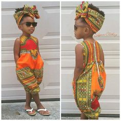 Little girl in African print all in one and matching head scarf