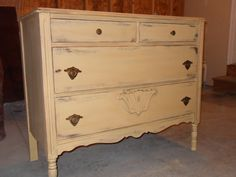Custom mix of annie sloan Arles and old white.  Then a stain lightly rubbed over the top and finished with polyurethane. painted dresser