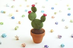 Love plants, cacti, or succulents? Well, I love all three. =) This little cactus doesnt need sun or water, because of course, its an amigurumi. Itll sit happily on your desk, or shelf, and is even a perfect pin cushion. This little crocheted cactus measures about 5.25/ 13 cm tall