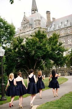 can't decide which i enjoy more -- the dress color or the venue. // Bridesmaids were outfitted in navy blue cocktail dresses and nude heels at this Georgetown University campus wedding.