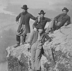 Private Henry McCollum of Company B, 78th Pennsylvania Infantry Regiment and three unidentified soldiers in 78th Pennsylvania Infantry uniforms at Point Lookout, Tennessee. Circa 1863.