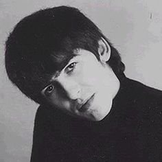 1964 - George Harrison in A Hard Day's Night film promo session (photo by Robert Freeman).