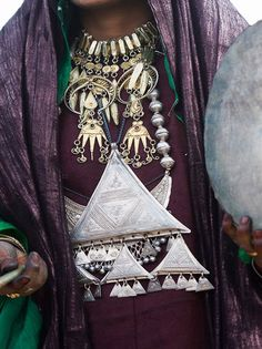 """Africa   """"Around her neck' a cha'riya silver dipped in gold and on her chest, a large takardé composed of triangles"""". Sebeiba, a Tuareg festival. Djanet region, south eastern Algeria   Image and caption ©Claudine et Denis Lionnet"""