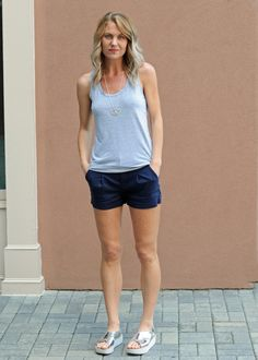 """This racer-back tank from La Made has a slim silhouette with a gentle flare at the hips for a flattering fit. Fit is true to size. Model is wearing a size small. Size small measures 25"""" in length. 100% cotton, machine wash, tumble dry low. $35.00"""