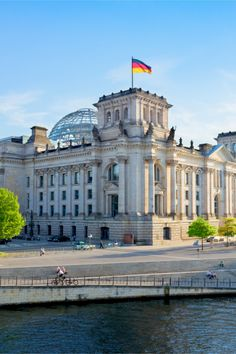 I believe this is a government building in Berlin. How cool would it be to ride a bike past these sites along the river like the person in the picture? Cities In Germany, Visit Germany, Berlin Germany, Germany Travel, The River, City Ville, Baltic Cruise, Berlin Travel, Germany Photography