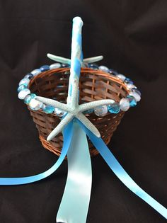 Finger Starfish Flower Girl Basket.  I like the idea of some type of shell in the center of the bows.
