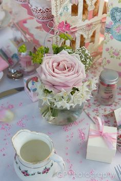 Vintage lace wedding collection of table products such as favours, rose petals, diamonds by www.fuschiadesigns.couk.