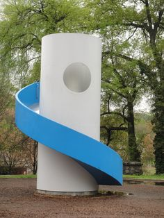 """Noguchi designed sculptural play equipment for all of his playground designs, including this spiral slide. His playgrounds provide a place of exploration rather than one of regimented play, telling the child what to do."""