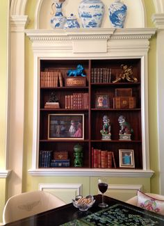 Bookshelf styling with books, sculpture and framed artwork  |  Andrea's Innovative Interiors - Andrea's Blog - The Mansion in Detail- part 1