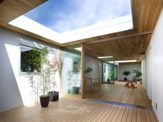 A modern Japanese house by Makoto Tanijiri with a hard surfaced material and very little green.