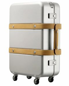Orion suitcase: an aluminum and natural cowhide luggage piece by Hermès design director, Gabriele Pezzini