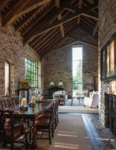 Love brick walls and an open space with visible rafters. Makes for the warmest combination