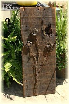 Ideas for making yard art from barn wood and other stuff Spigot handles were thrift shop finds