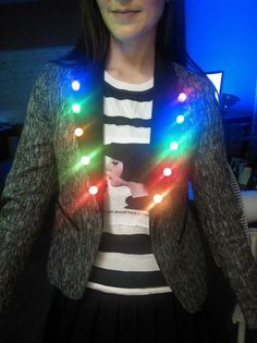 LED Light Costumes: You *can* make LED clothing yourselves, costume crafters, plus take note for Halloween, guys. These LED lights are clip on, you can put them anywhere and everywhere: http://www.flashingblinkylights.com/light-up-products/light-up-flashing-pins-body-lights/blinkies-round-leds.html