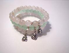 Ganesha Bracelets - sterling silver pedants, rose quartz and blue quartz gemstones.