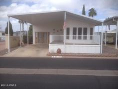 This beautifully maintained manufactured home located in gated Superstition Mountain Resort. This home is updated and has a wrap around deck and wonderful Arizona room. Washer and dryer in the home. Sunscreens and awnings help keep the home cool in the summer. This community offers everything from a heated swimming pool, billiards, bocci ball, pickle ball, library, laundry room along with planned activities from the clubhouse. Just a short distance to town and freeway