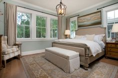 Traditional Master Bedroom with Pendant Light, Hardwood floors, Carpet, High ceiling, Crown molding