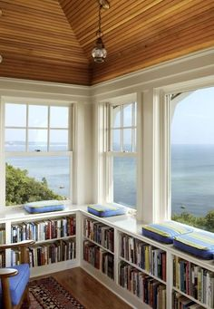 Windows with the view of the sea, bookshelves <3 I love this! This is seriously perfect!! <3 | dream house