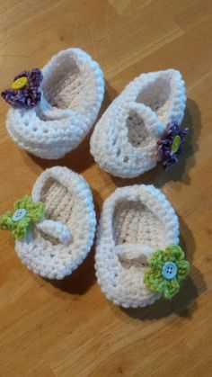 Mary Jane baby booties with flowers.  Get them custom made in your choice of colors at https://www.etsy.com/listing/204417288/one-pair-of-crocheted-mary-janes-for?ref=shop_home_active_14