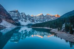 MORAINE LAKE, BANFF NATIONAL PARK - People come from all over the world to visit Moraine Lake, which is situated in the Valley of the Ten Peaks in Lake Louise. The blue/green color of the lake is one your memory will not soon forget after visiting, and with its romantic feel it makes for the perfect wedding location. Rent a canoe or bring your runners and set out on a hike too see Moraine from a bird's eye view.