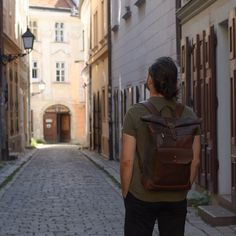 Simple and elegant waxed canvas and leather backpack was made in the best traditions of minimalist clear design. It's ideal bag for daily use, work and studying.