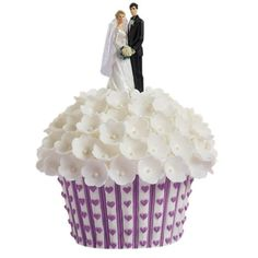 Made with the Dimensions® Giant Cupcake Pan, this cake is beautifully detailed with fondant flowers and violet buttercream hearts.