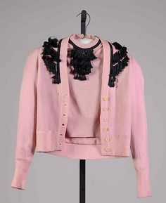 Pink wool or synthetic evening sweater set with black silk trim, by Mainbocher, American, ca. 1948.