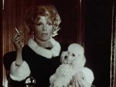 0 Rita Hayworth with poodle in Poppies are also Flowers (1966)