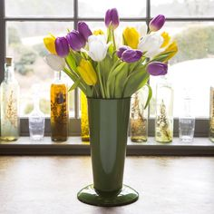 Love this green enamelware floral bucket, don't you? Simple, elegant, and practical. These colorful tulips look terrific against the deep green glaze.