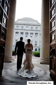 Columbia University Campus -  Bride & groom exiting St. Paul's Chapel after their wedding, looking west at Low Library ...