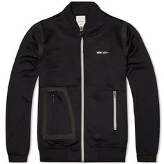 This Wood Wood jacket kind of looks like it was made by mistake. The pocket on one side looks totally normal, but then there's the other side with the sealed-on patch and zip pocket and it feels like one of
