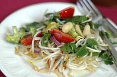 Bean Sprout Salad Recipe  I know it's not a fancy recipe but it's spring and all I want to eat are fresh salads.  I bought the bean sprouts and came home and picked the herbs and in 15 minutes we were eating.  It's simple and delicious.  http://www.orgasmicchef.com/salads/bean-sprout-salad/