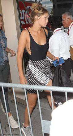 Gigi Hadid flashes sideboob at Taylor Swift show with beau Joe Jonas #dailymail