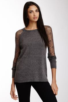 """Open Knit Sleeve Pulloverby Carducci $145 - $35 @HauteLook. - Wide crew neck - Long open knit sleeves - Back zip closure - Small ribbed trim - Side slits - Approx. 28"""" length Model's stats: - Height: 5'10.5"""" - Bust: 34"""" - Waist: 25"""" - Hips: 36"""" Model is wearing size S. Hand wash. 50% nylon, 40% acrylic, 5% angora, 5% lurex."""