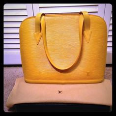 ⛔️SOLD⛔️ 💯Authentic Louis Vuitton Yellow Epi 💯Authentic. Comes with dustbag. Pre-loved condition. Interior is in excellent condition. Exterior show some minor scratches. Please email me at Chanelamoureux @ gmail for more pics. 🚫🚫TRADE. I just update with the matching wallet! And price is FIRM! Louis Vuitton Bags