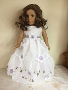 Adorable garden tea party dress for 18 dolls. Lined flowy white fabric with pretty violet flower appliqués and pink sequin trim. Gorgeous ruffles and embroidery on hem. So cute