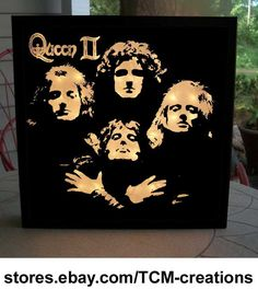 Queen shadow box with LED lighting.  Freddie Mercury, Brian May, Roger Taylor, John Deacon, Queen II, Sheer Heart Attack, A Night At The Opera, A Day At The Races, News Of The World, Jazz, The Game, Flash Gordon, Hot Space, The Works, A Kind Of Magic, The Miracle, Innuendo, Made In Heaven.
