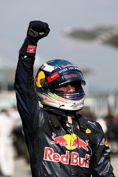Daniel Ricciardo of Australia and Red Bull Racing celebrates his win in parc ferme during the Malaysia Formula One Grand Prix at Sepang Circuit on...