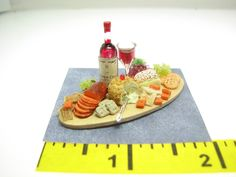 Dollhouse Miniatures Wine Cheese Crackers Board 1:12  All hand made, highly detailed Cheeses and Crackers, displayed on a Buffet Board serving Wine and Fruit By Artisan Jan Yinger