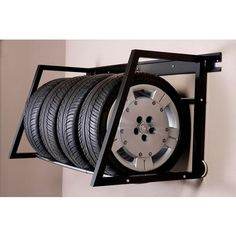 This Tire Loft from Hyloft is a great place to store your winter or all-season tires when you're not using them. #Storage #Organize #Garage
